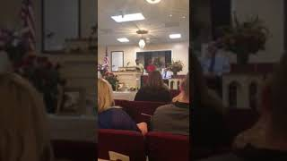 Brothers sing Amazing Grace at Grandfathers funeral