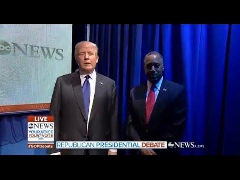 • Donald Trump waits for Ben Carson at New Hampshire debate intro • 2/6/16 •