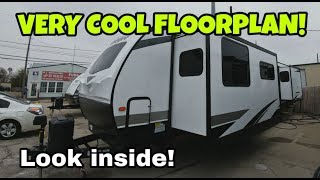 Very Cool Travel Trailer RV Floorplan with an awesome kitchen!