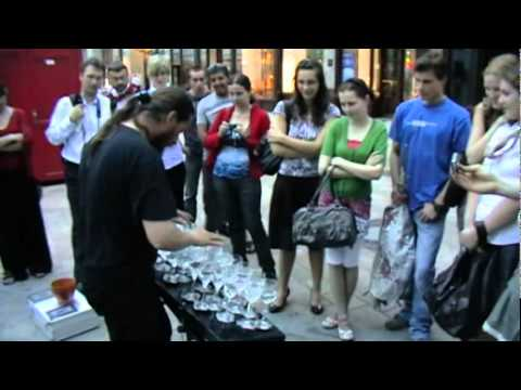 Crazy wine glass musician in Bratislava