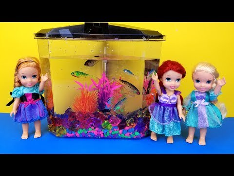 FISH TANK ! Elsa and Anna toddlers visit Ariels house - aquarium decorating - playdate - prank