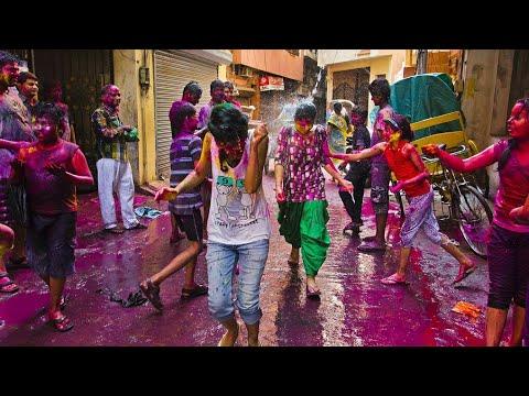 Holi festival (India) vs Battle of wine  (Spain)