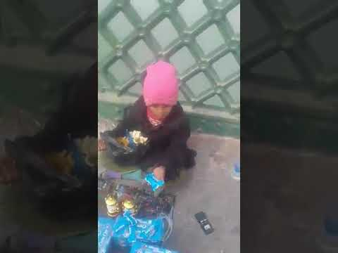 little girl selling some sweets