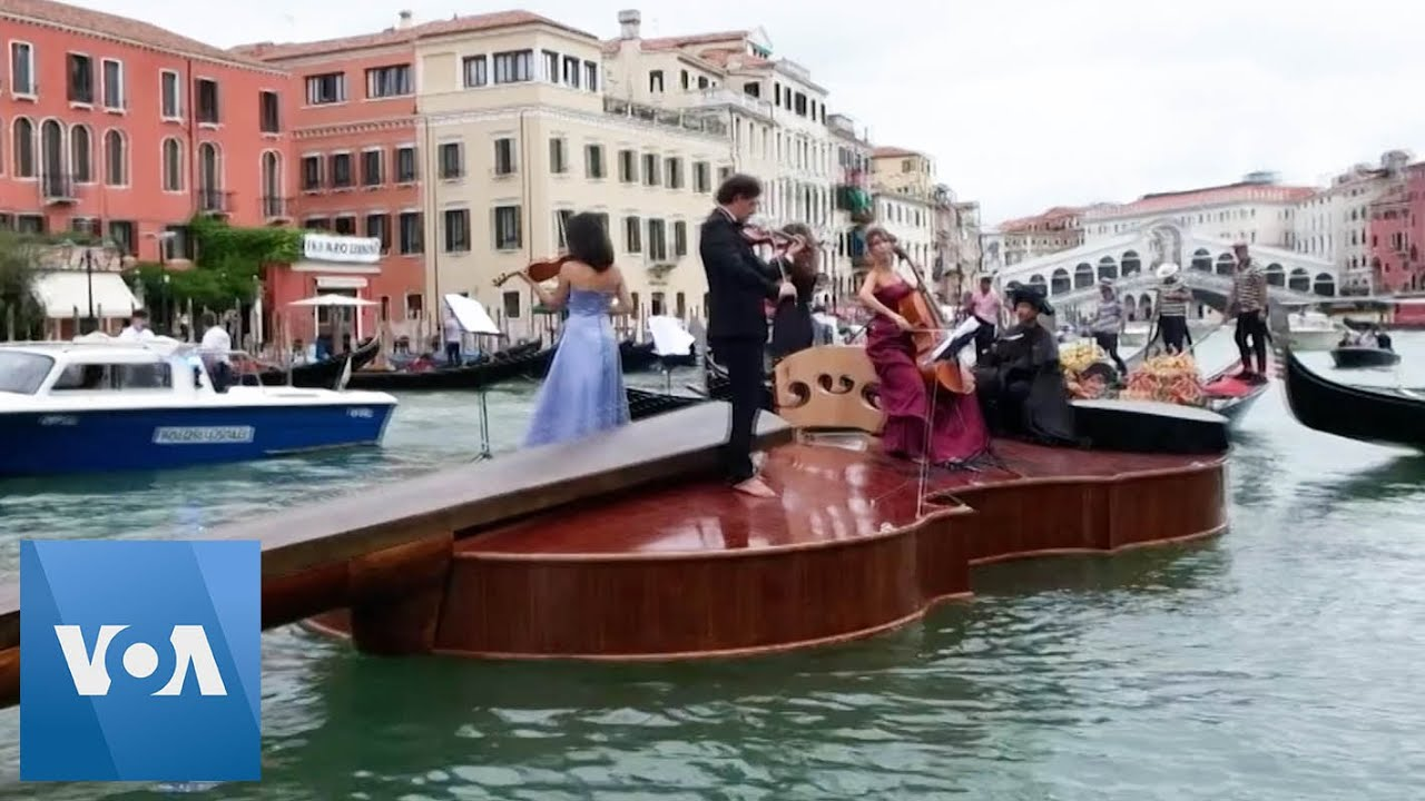 A Gigantic Violin Floats Down Venice's Grand Canal with a String Quartet on Top