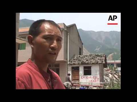 Soldiers evacuate 160,000 under threat from quake-created dams