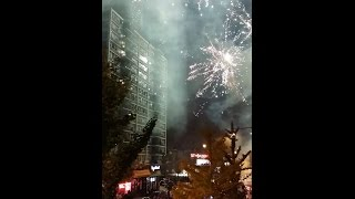 Massive Fireworks in the streets of chicago for Cubs win.