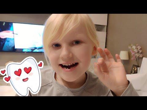 Как вырвать молочный зуб в домашних условиях ;))