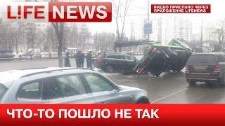 Эвакуатор упал на машину во время погрузки в Москве(, 2015-01-29T12:04:46.000Z)