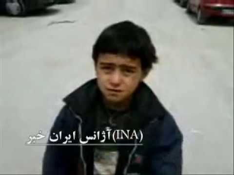 8 year old street child in Iran talks to cameraman