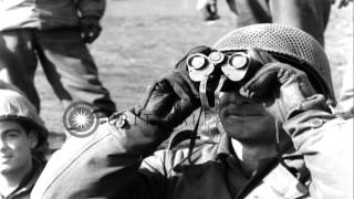 Near the end of World War II in Europe,  American artillerymen fire several round...HD Stock Footage