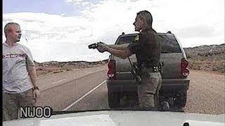 Repeat youtube video MAN TASED BY BORED UTAH COP...AND GETS $40,000!