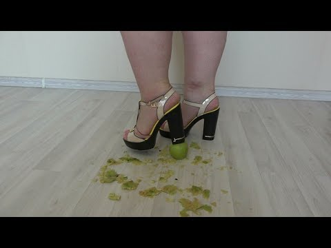 bbw in high-heeled shoes to crush apples