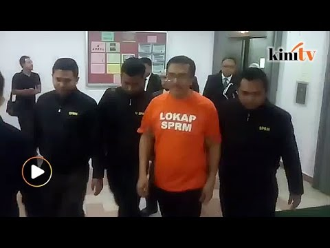 Johor exco brought to magistrate's court for remand