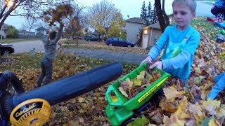 Kids playing with Leaf Vacuum John Deere Dump trucks