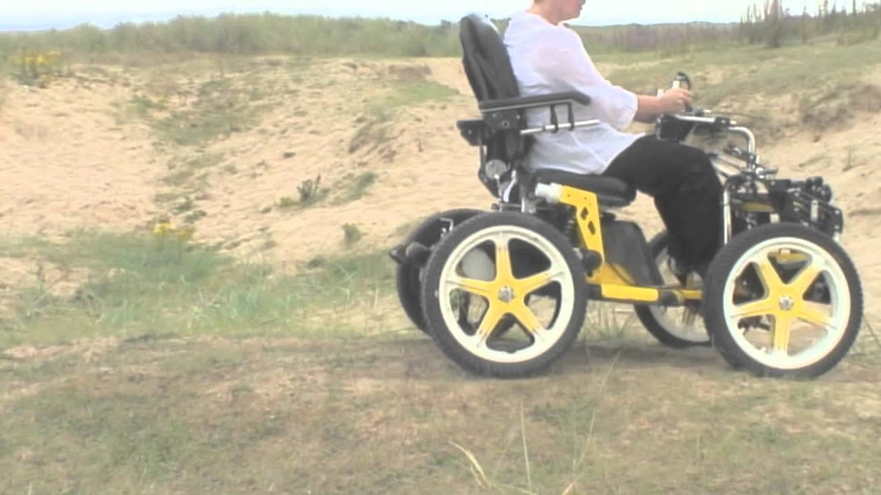 all terrain electric wheelchair portable chairs argos terrainhopper the beach youtube