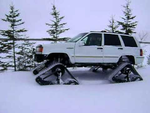 Cherokee For Less >> jeep with tracks playing in snow. - YouTube