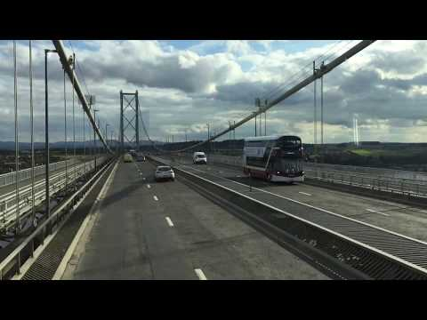 Travelling Over The Forth Road Bridge With A View Of The Queensferry Crossing