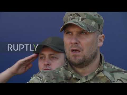 Ukraine: Far-right Azov Battalion hold parade on 5th anniv. of Mariupol 'victory'