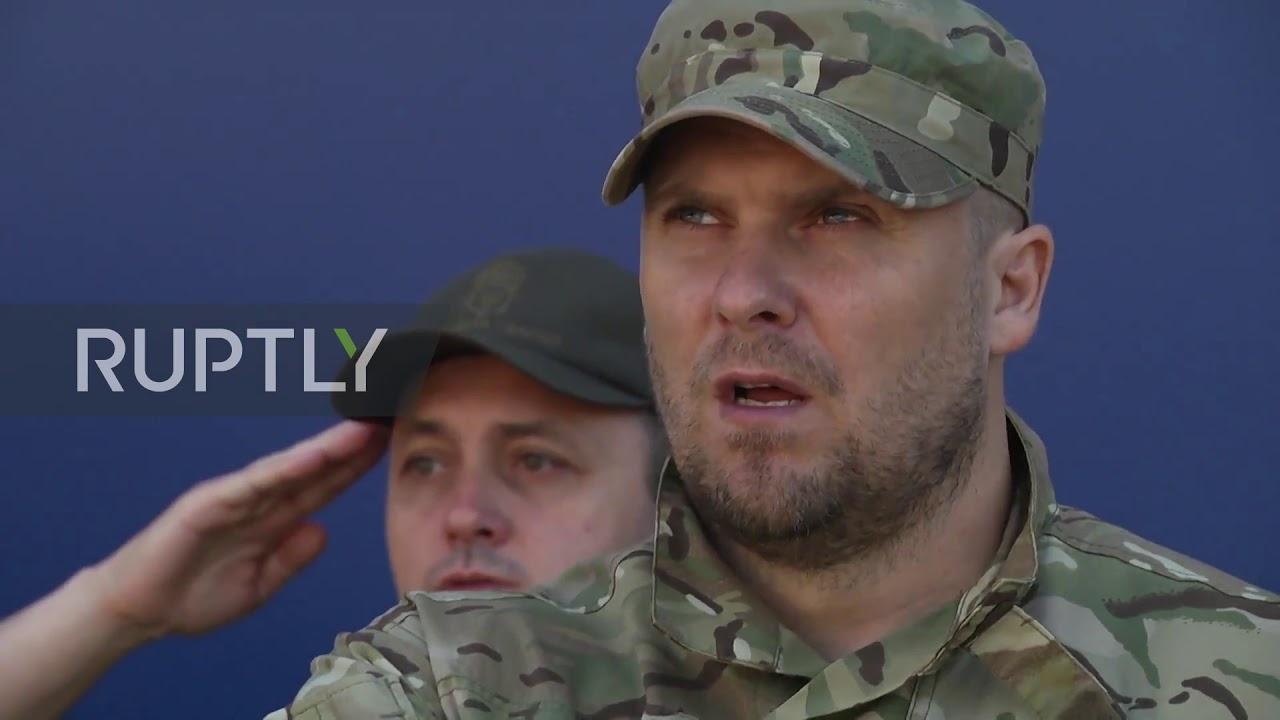 Ukraine: Far-right Azov Battalion hold parade on 5th anniv. of Mariupol 'victory' (WAKE UP BLACK FOL