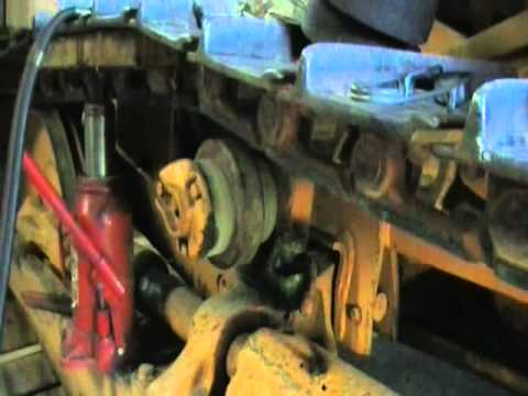 John Deere 350 Upper Track Roller Replacement Pt 1