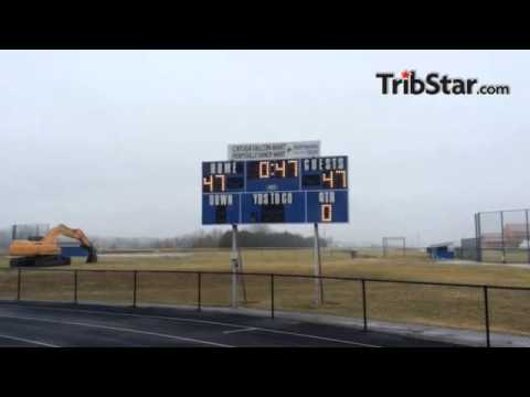 The scoreboard at North Vermillion High School is lit for No. 47 Braeden Hollowell, who died in a Fr