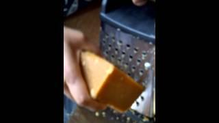 Grating organic jaggery (panela) for easier use.