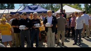 WATCH: President Trump Gives Food To Hurricane Florence Victims In North Carolina