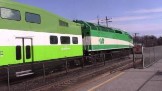 GO train meets double VIA Rail train at Rouge Hill station.