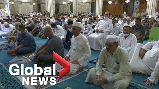 Muslims attend Eid al-Adha prayers in the Middle East