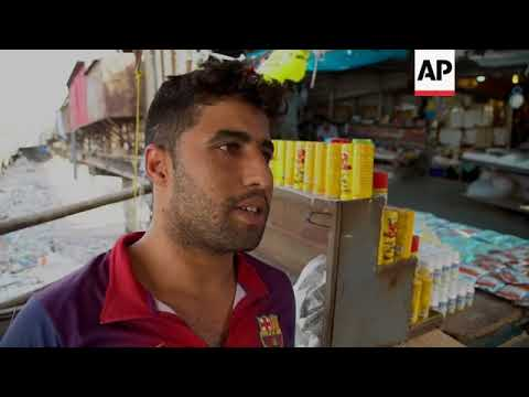 Kirkuk residents divided ahead of Kurdish vote - YouTube