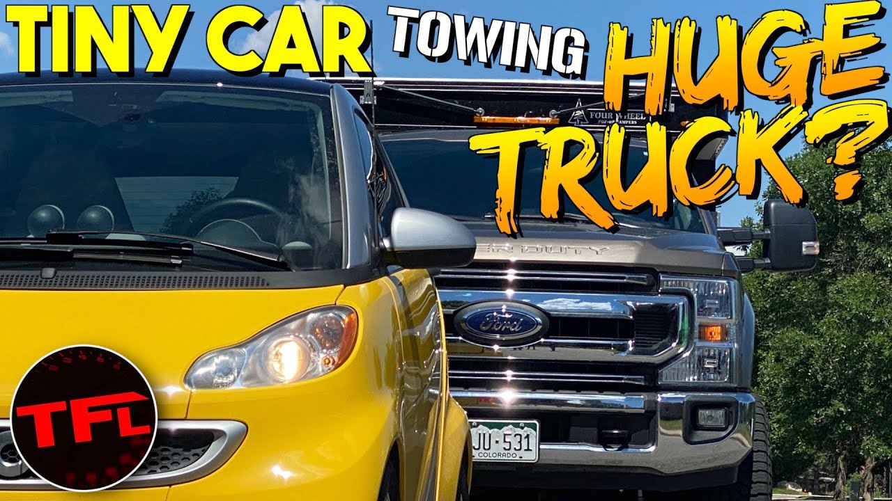 Can I Tow a GIANT Truck With A TINY Car? | Ford F-250 vs Electric Smart Car!