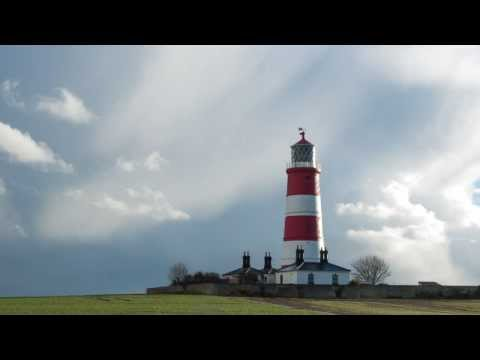 time lapse happisburgh lighthouse with passing squall