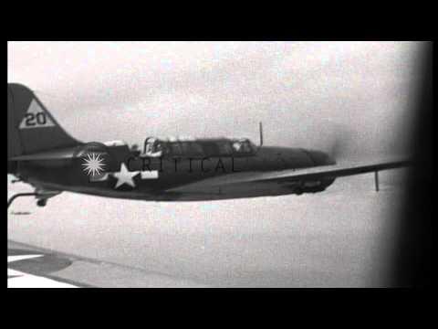 US Navy SB2C Helldiver bombers raid Bonin Islands, Japan during World War II. HD Stock Footage