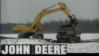 Army 6x6 Dump Trucks Hauling & John Deere 892E LC Loading