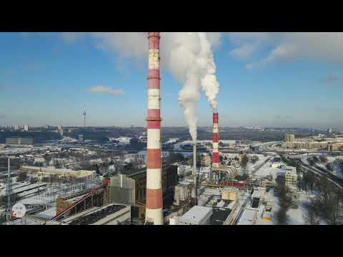 Vilnius thermal power plant in mid-winter  / 4k areal video