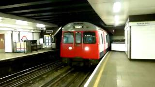 Circle Line Train at Tower Hill Station in London