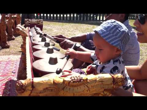 10 months old playing gamelan music