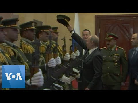 Putin Replaces Dropped Cap of Palestinian Honor Guard