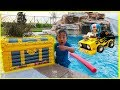 Ryan found treasure with surprise toys in our swimming pool!!! Car Racing playtime fun!!!!