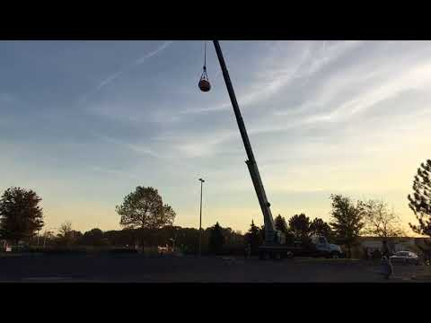 Giant 1,400 pound pumpkin dropped from 140 feet for Smiley Radio Show's annual Pumpkin Drop