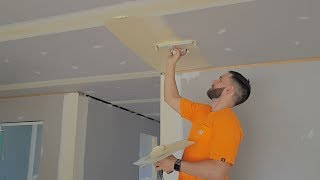 Drywall Construction Workers Finish Coating Room in Minutes
