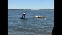 Blue shorts blue paddle board fail