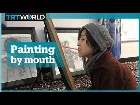 Afghan painter drawing with her mouth