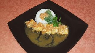 Рыба в томатном соусе с рисом.