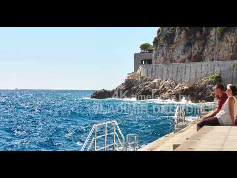 Monaco, Monte-Carlo, 06.09.2015: Port de Hercule, port Hercules, concrete beach, road to Sea museum