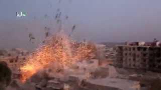 إنفجار هائل جراء إنفجار أربعة براميل متفجرة قبل قليل على مدينة داريا