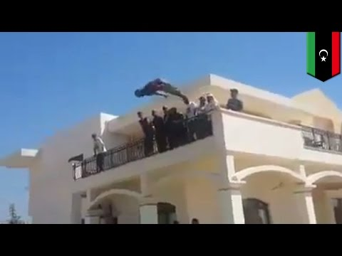 Dawn of Libya militants storm abandoned U.S. Embassy in Tripoli and have a swim