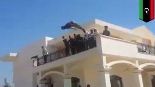 Dawn of Libya militants storm abandoned U.S. Embassy in Tripoli and have a swim