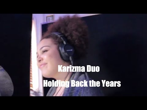 Holding Back the Years chilled acoustic cover by Karizma Duo Mp3