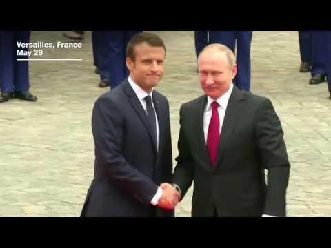 Putin and Macron shake hands in Versailles